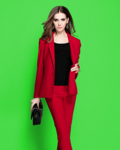 red outfit on green background